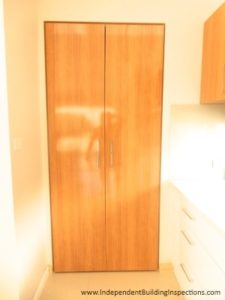 Pre-handover inspection shows kitchen joinery defects