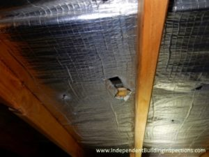 pre-handover inspection shows damaged sarking in the roof space